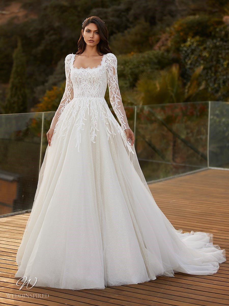A Pronovias 2021 lace and tulle sparkly ball gown wedding dress with long sleeves