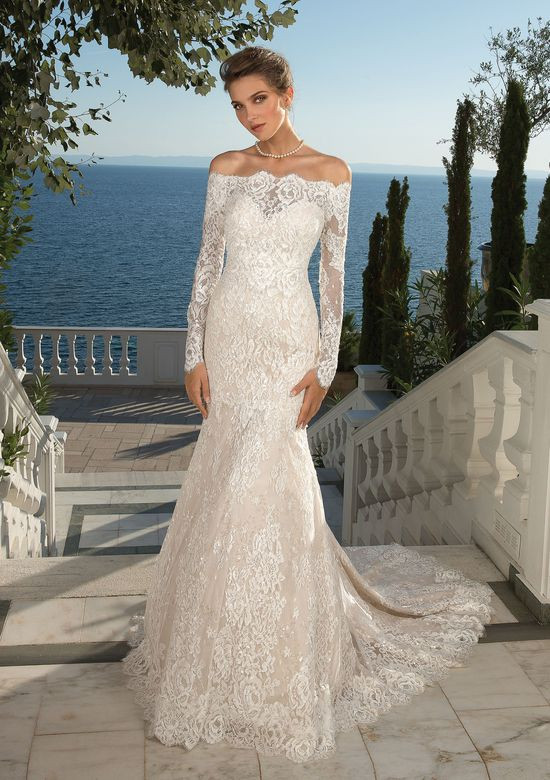 An off the shoulder lace mermaid wedding dress with long sleeves