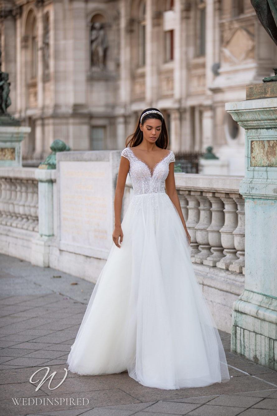 A Milla Nova sparkly off the shoulder princess ball gown wedding dress