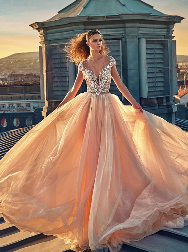 A Galia Lahav pink blush tulle ball gown wedding dress