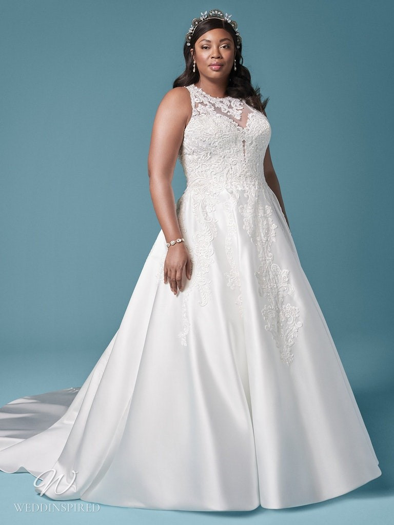 A Maggie Sottero 2021 plus size lace and silk ball gown wedding dress