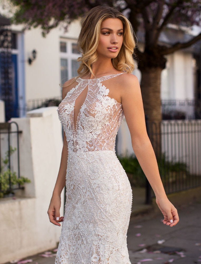 A Milla Nova lace halterneck mermaid wedding dress