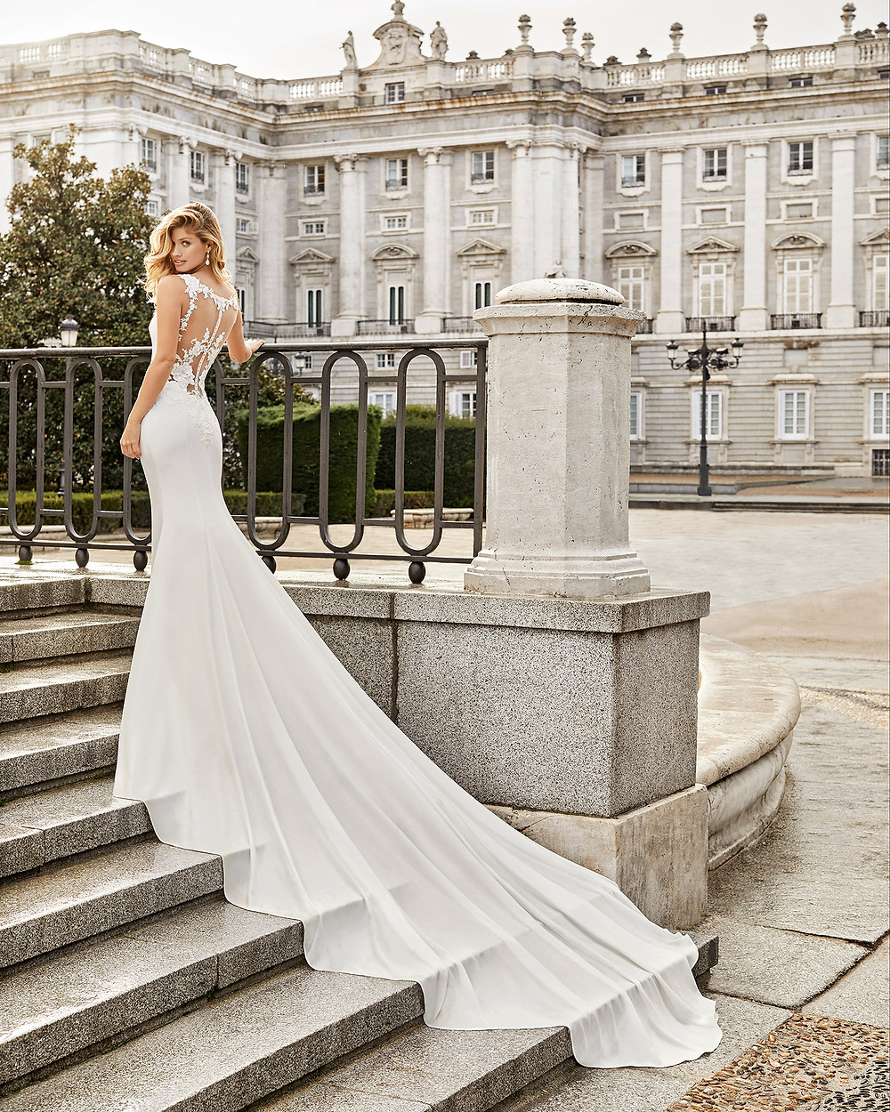 An Aire Barcelona 2020 crepe and lace mermaid wedding dress with a train and an illusion back