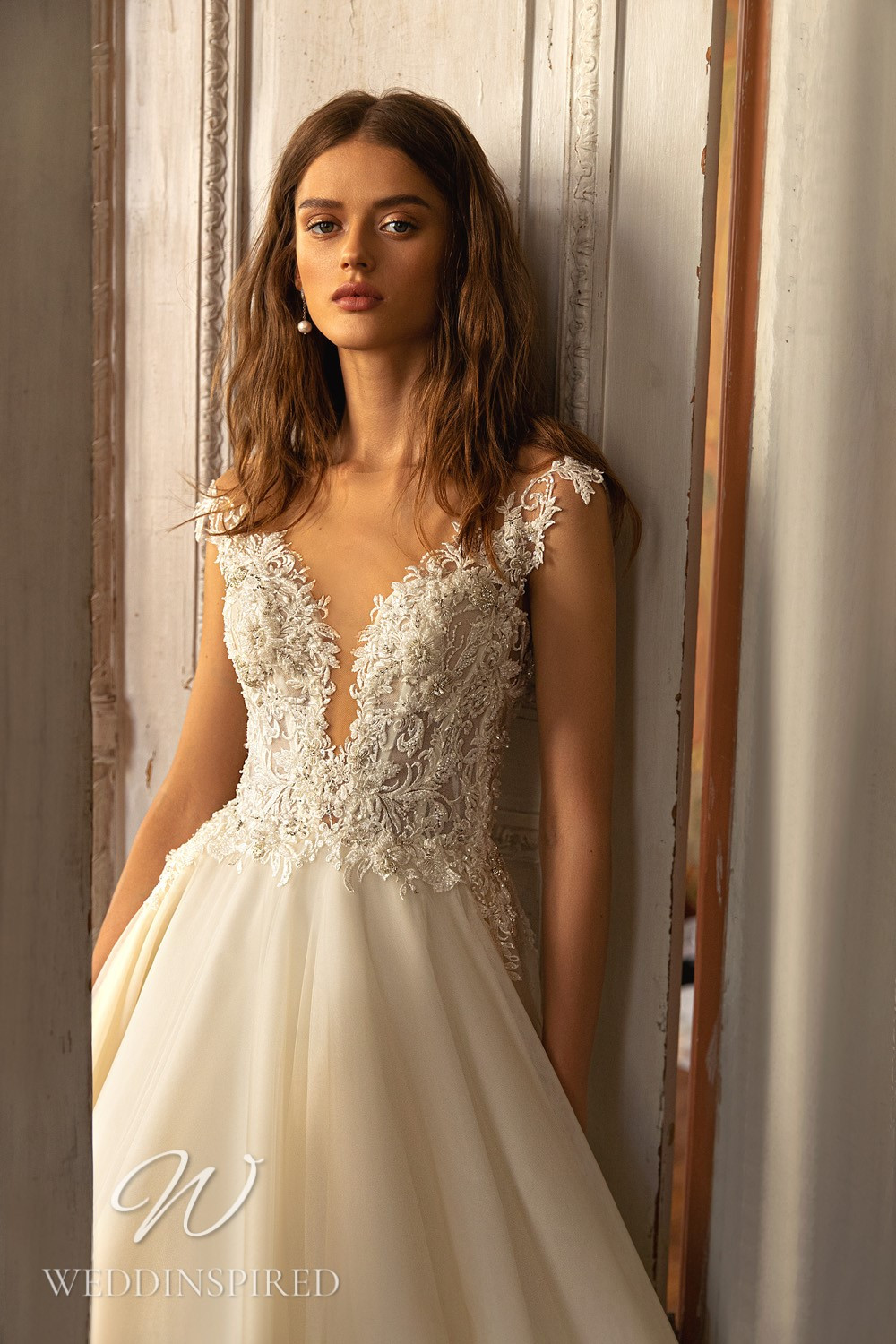 A WONÁ Concept 2021 ivory lace and tulle A-line wedding dress