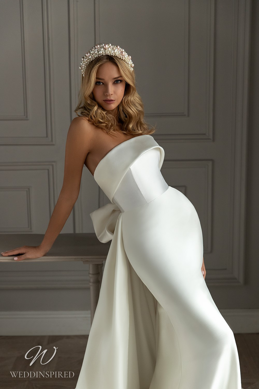 An Eva Lendel 2021 strapless silk mermaid wedding dress with a big bow