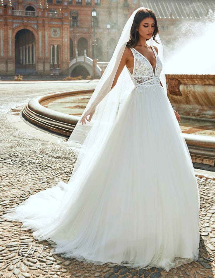 A Marchesa for Pronovias 2022 lace and tulle ball gown wedding dress with a v neck and straps