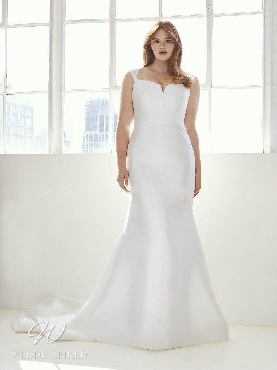 An Ashley Graham x Pronovias 2021 plus size simple satin mermaid wedding dress with straps