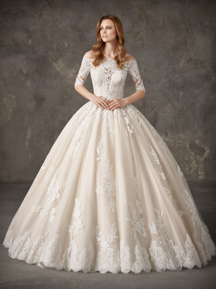 A Pronovias lace 3/4 sleeve, ball gown wedding dress, with a big skirt