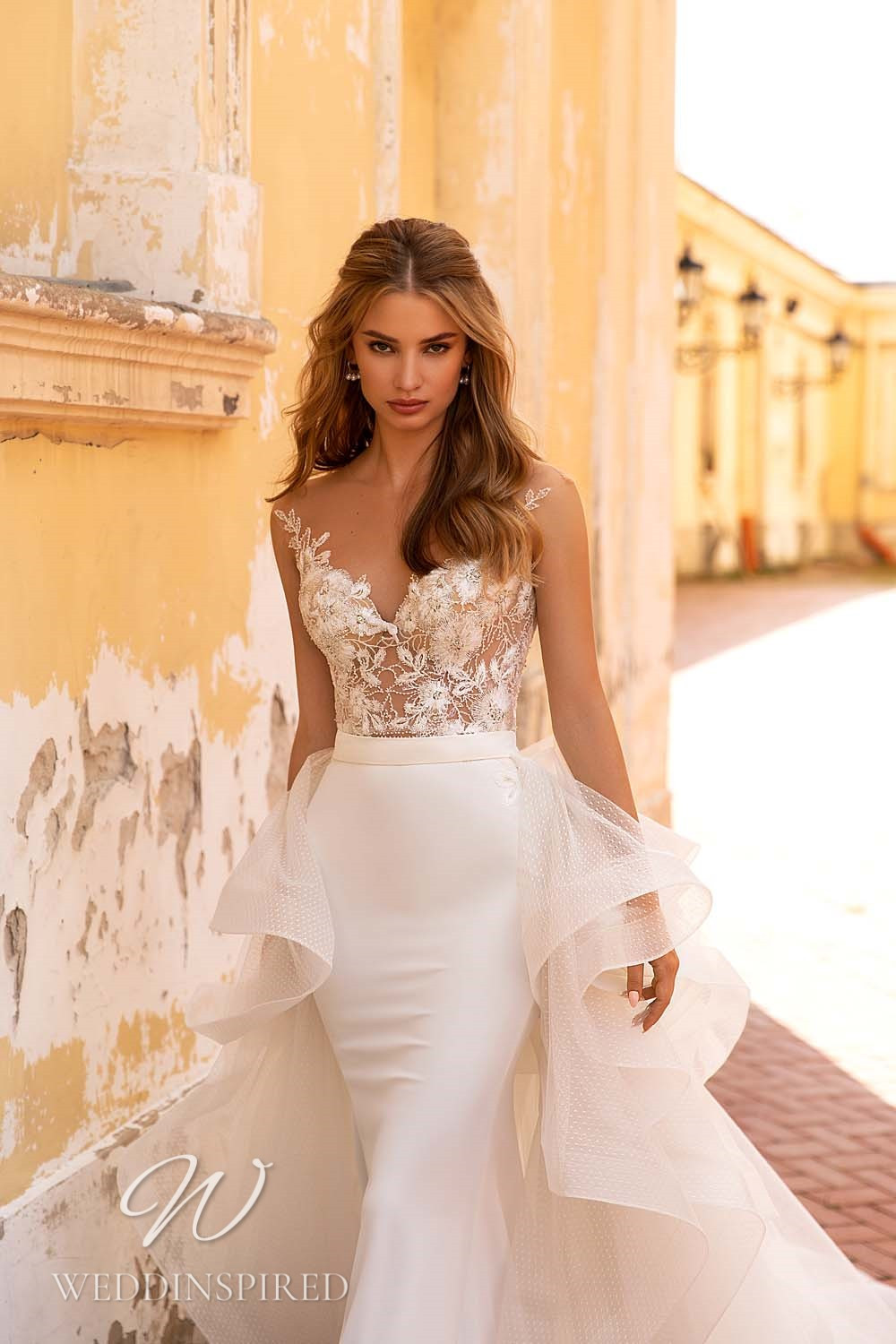 A WONÁ Concept 2021 lace and satin mermaid wedding dress with a detachable skirt
