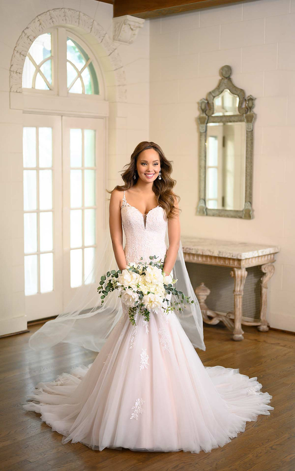 A Stella York 2020 blush lace and tulle mermaid fit and flare wedding dress with straps
