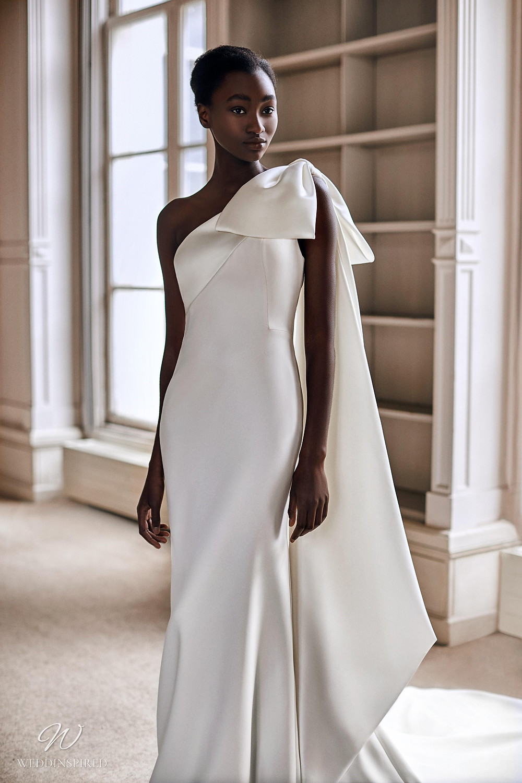 A Viktor & Rolf 2021 one shoulder mermaid wedding dress with a shoulder bow
