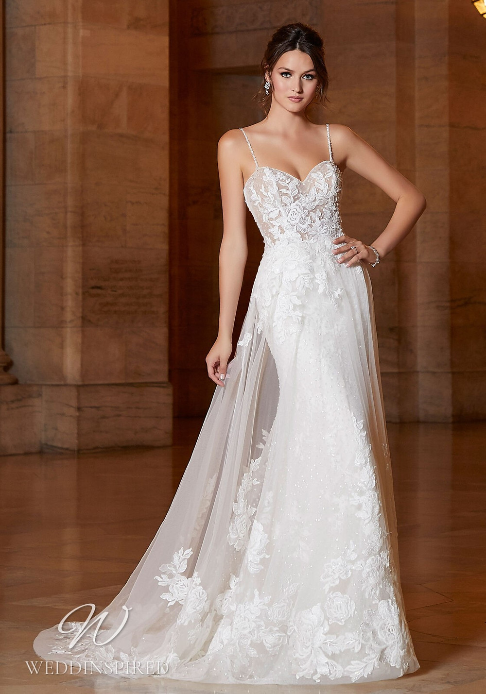 A Madeline Gardner lace mermaid wedding dress with straps