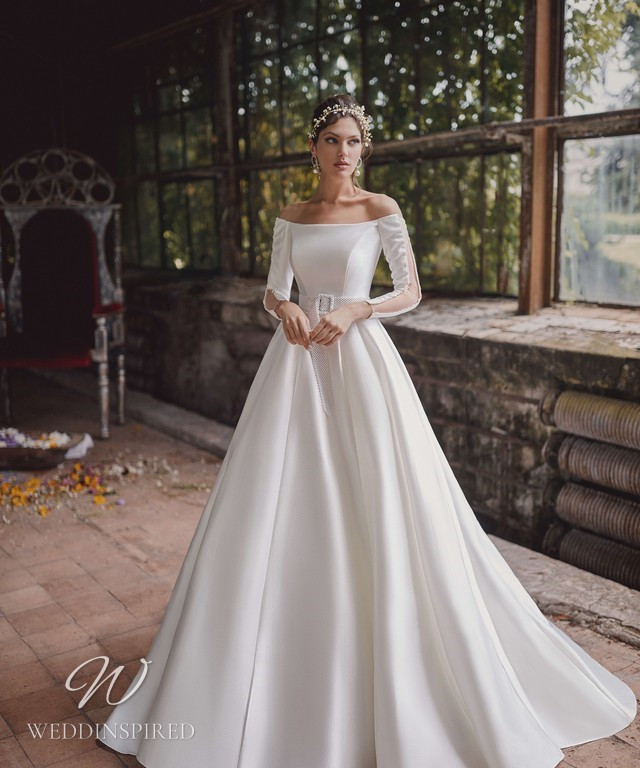 An Ange Etoiles 2021 off the shoulder silk ball gown wedding dress with long sleeves