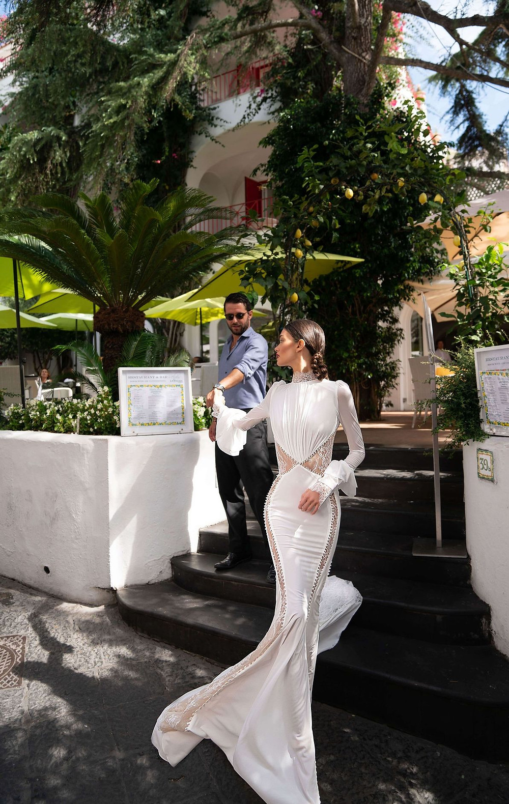 An Inbal Dror mesh mermaid wedding dress with long sleeves and lace