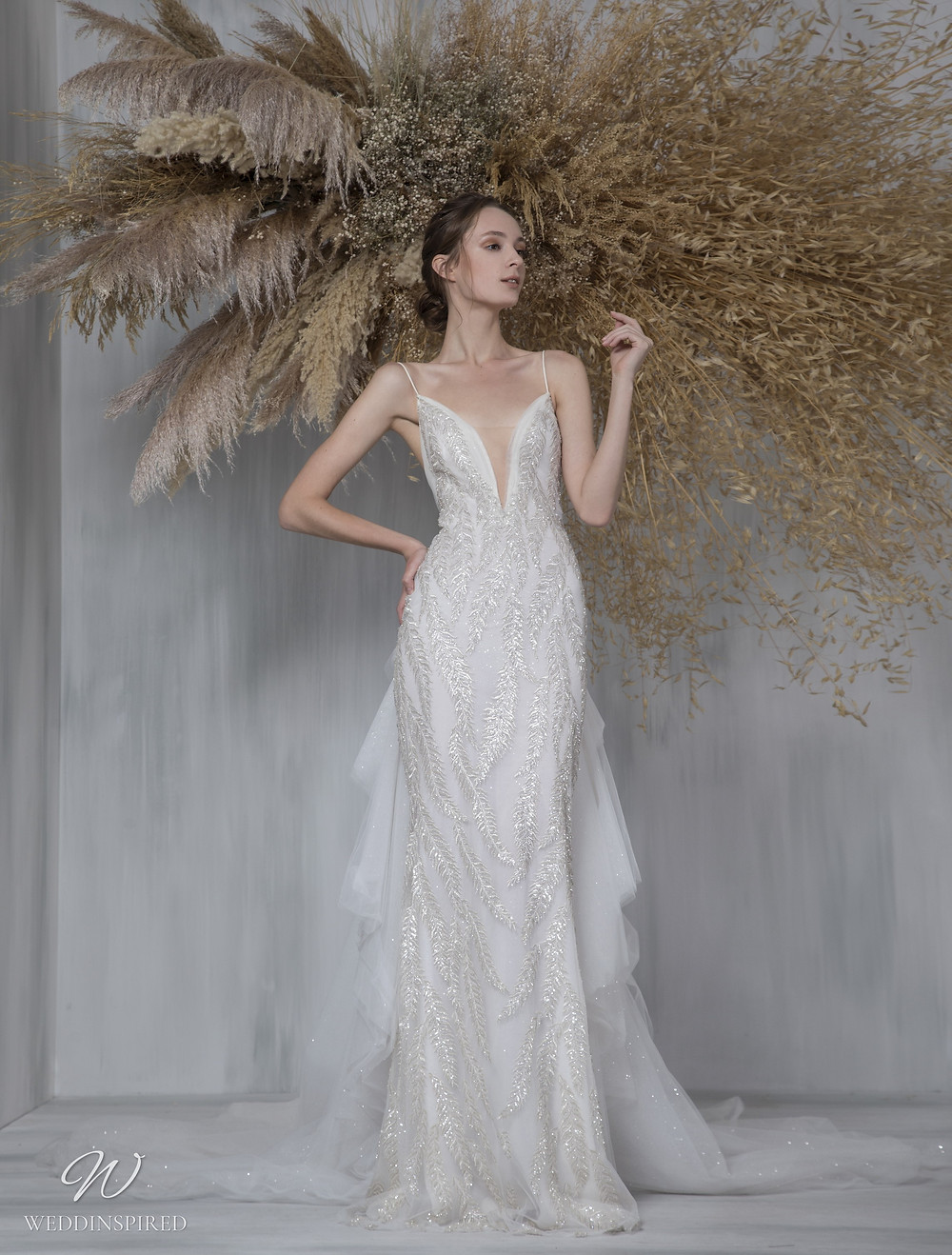 A Tony Ward 2021 tulle and mesh mermaid wedding dress with sparkly beading, a v neck and straps