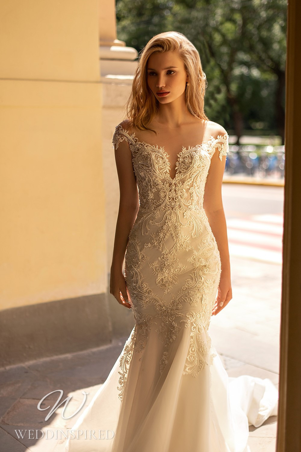 A WONÁ Concept 2021 ivory lace and tulle off the shoulder mermaid wedding dress