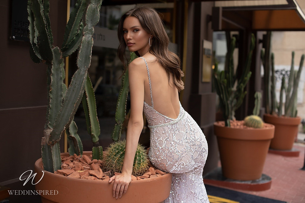 An Eden Aharon 2020 sparkly mesh mermaid fit and flare wedding dress with straps and a low back