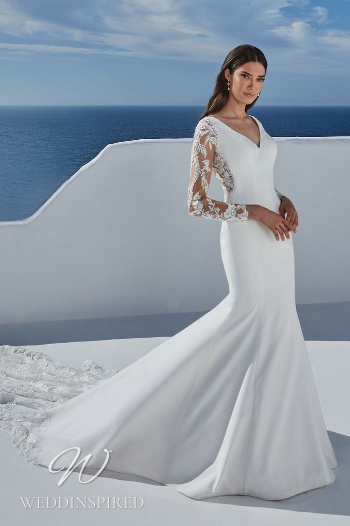 A Justin Alexander 2021 satin and lace mermaid wedding dress with long sleeves