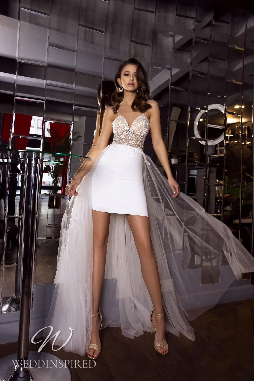 A Tina Valerdi lace and satin short wedding dress