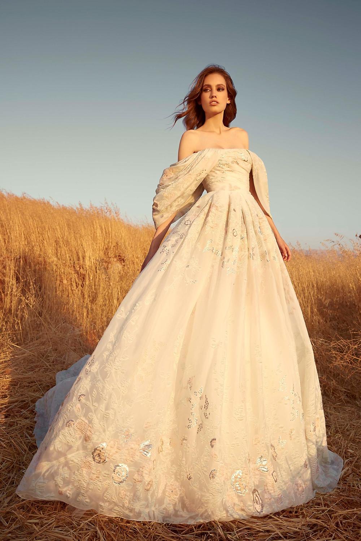 A Zuhair Murad off the shoulder blush princess ball gown wedding dress