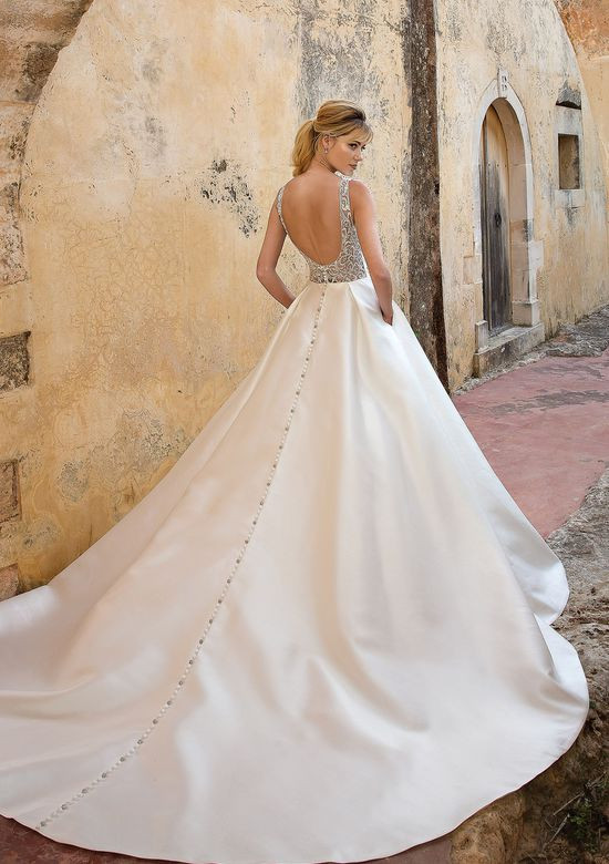 A Justin Alexander silk and beaded mesh ball gown wedding dress with pockets, a low back and buttons