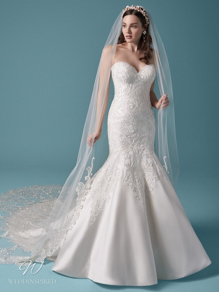 A Maggie Sottero 2021 strapless lace and silk mermaid wedding dress