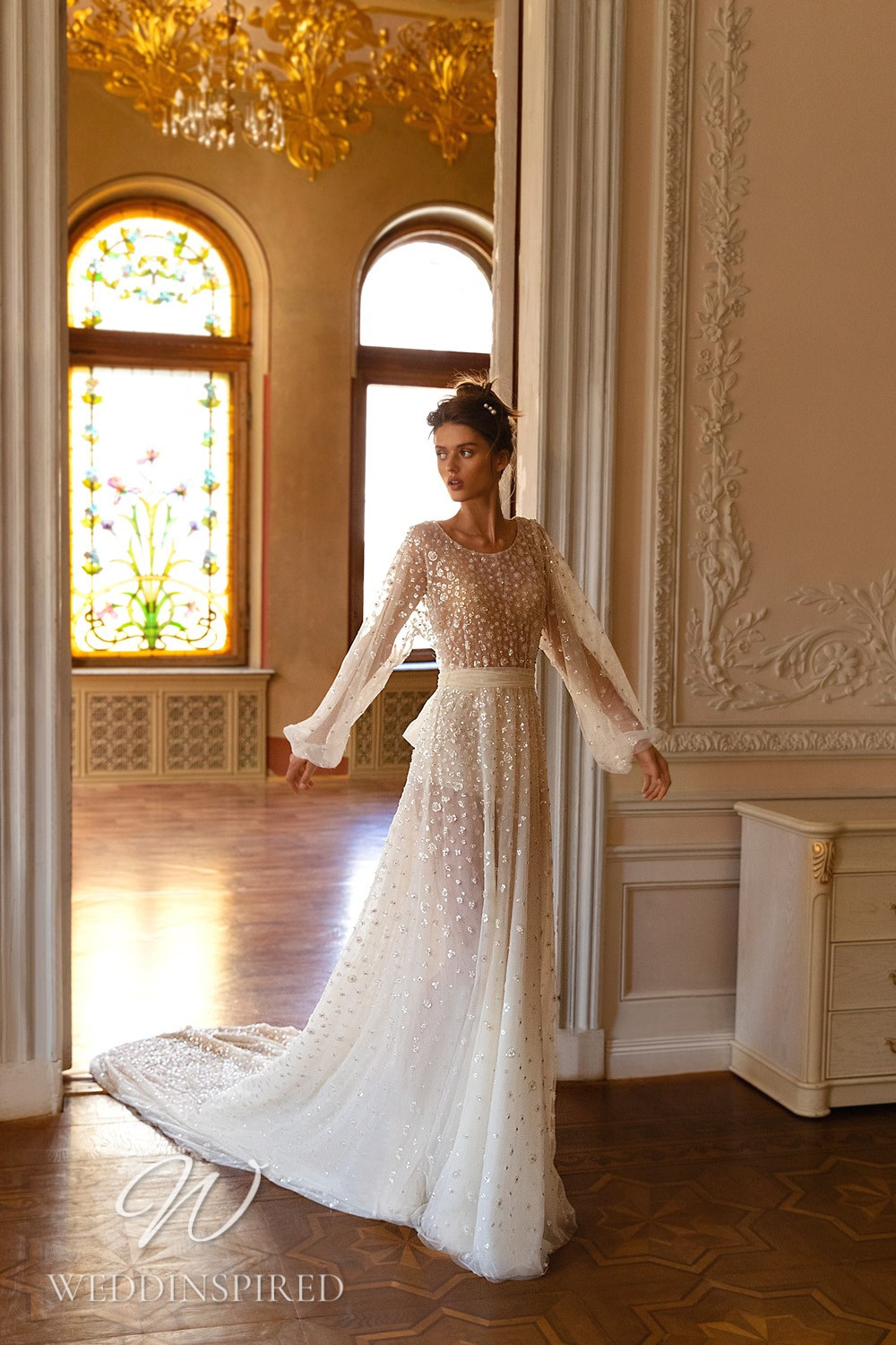 A WONÁ Concept 2021 tulle A-line wedding dress with long sleeves