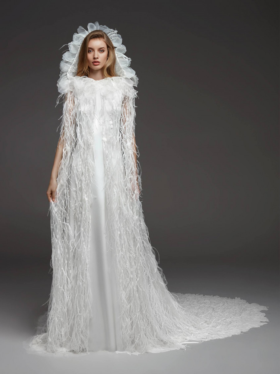 A Pronovias feather and silk sheath wedding dress with a cape