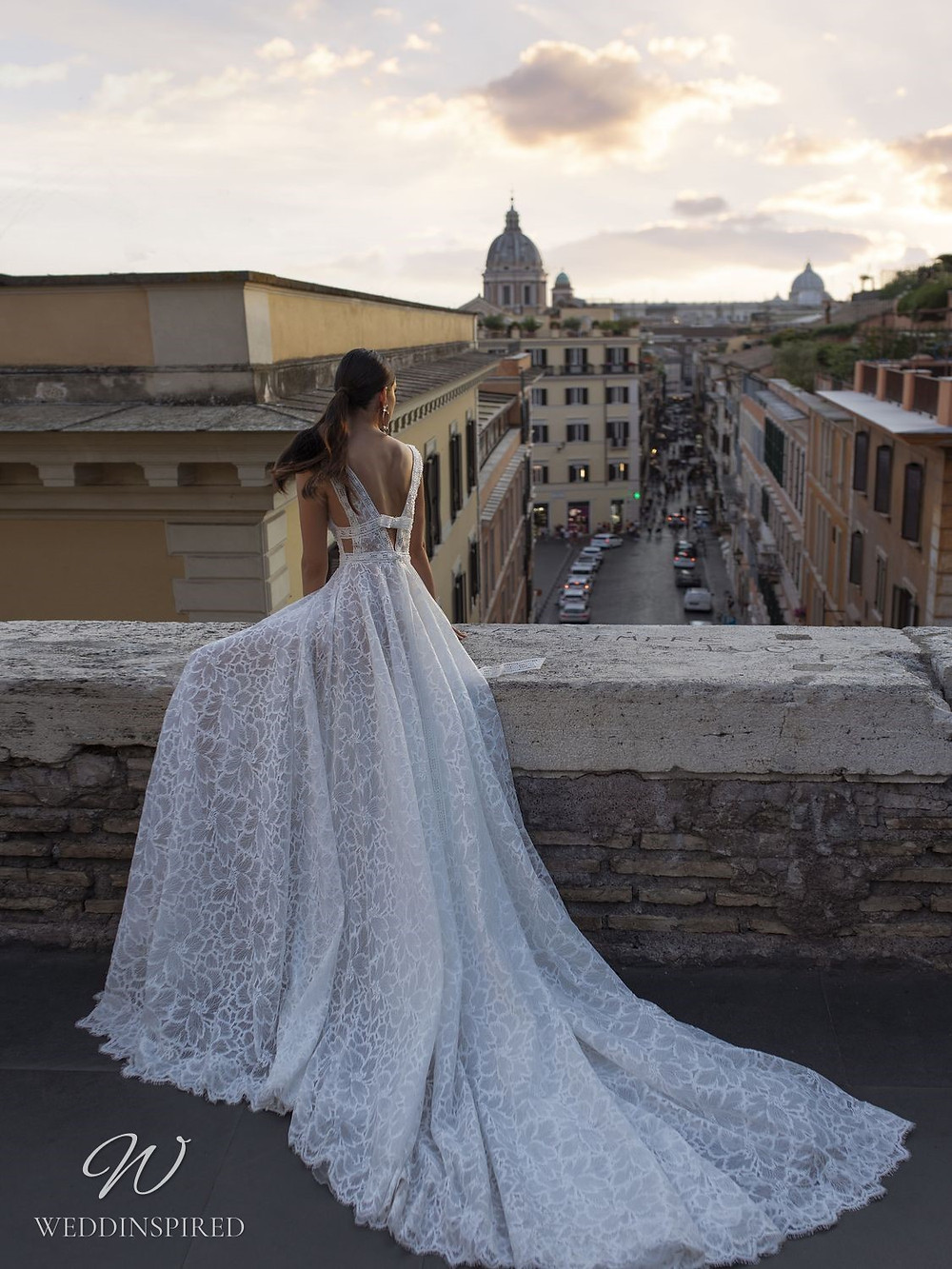 A Pinella Passaro lace A-line wedding dress with a low back