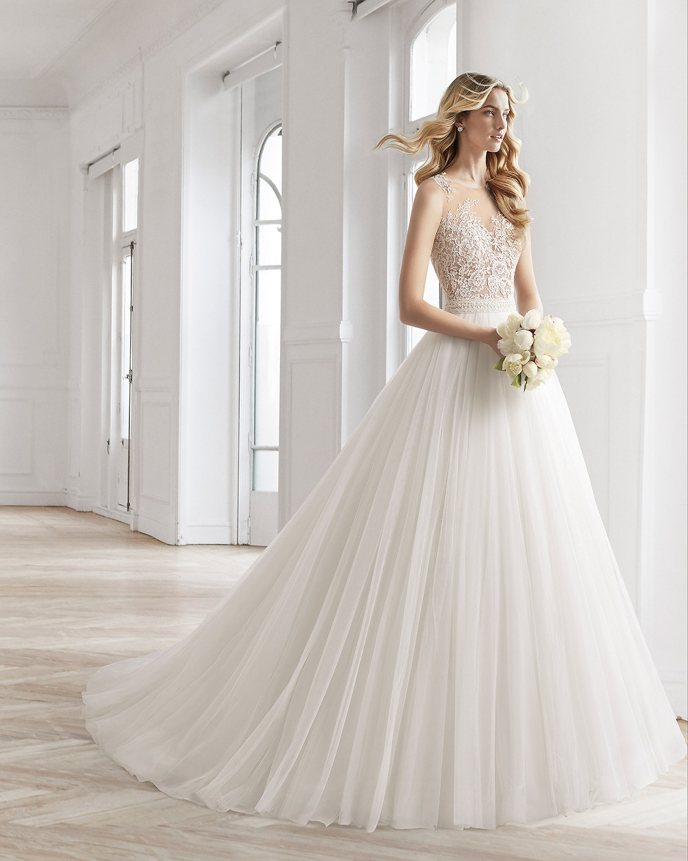 An Aire Barcelona 2020 lace and tulle ball gown wedding dress with an illusion neckline