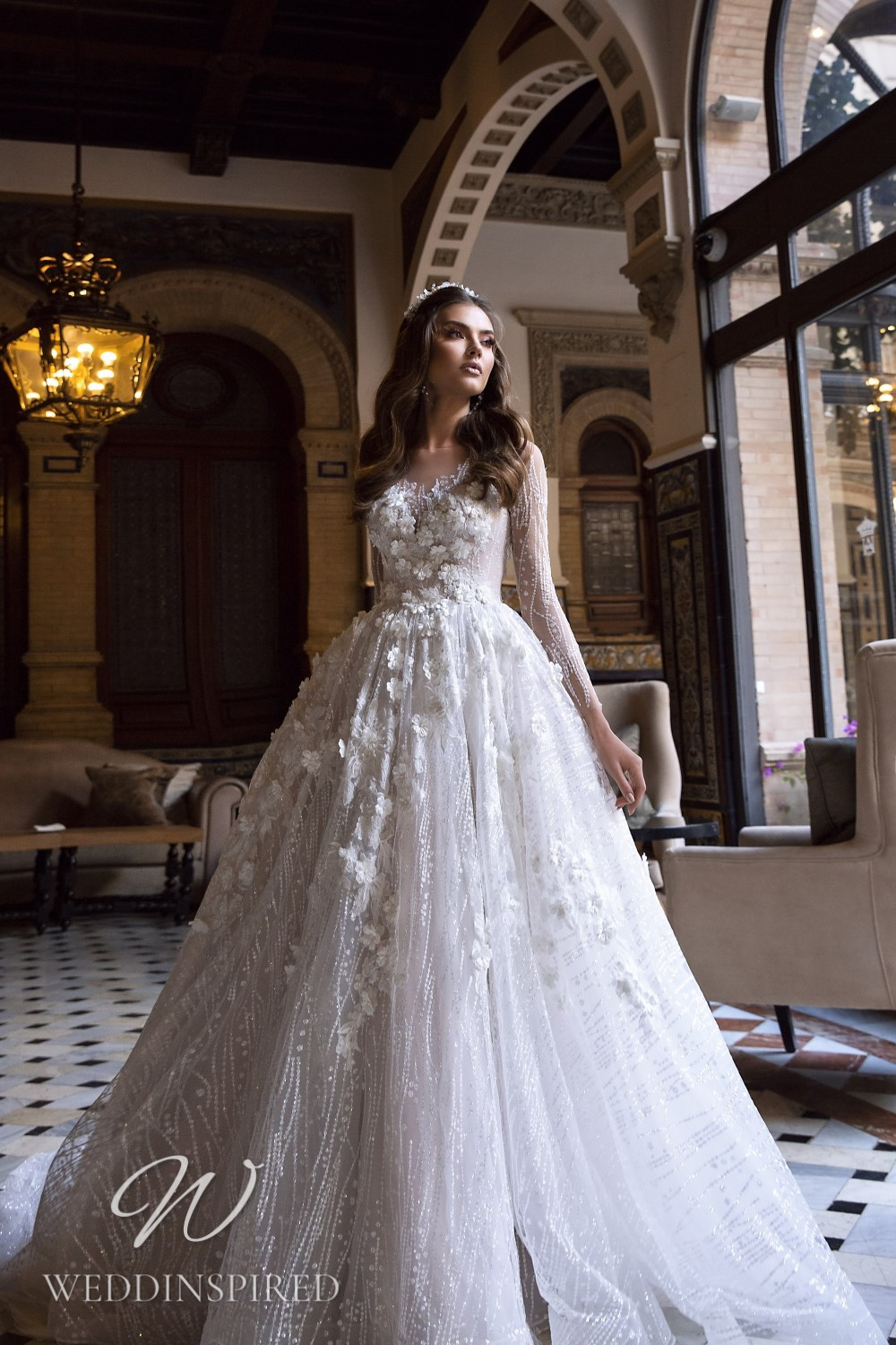 A Maks Mariano tulle and lace princess wedding dress with long sleeves