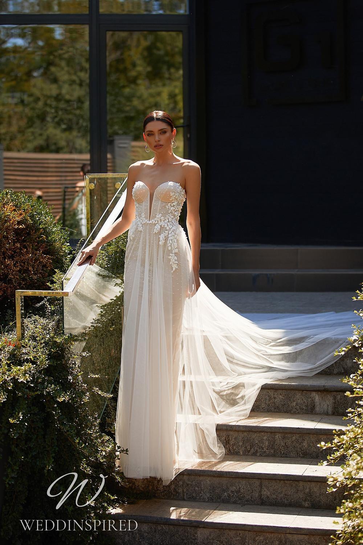 An Ida Torez 2021 strapless blush tulle and lace A-line wedding dress