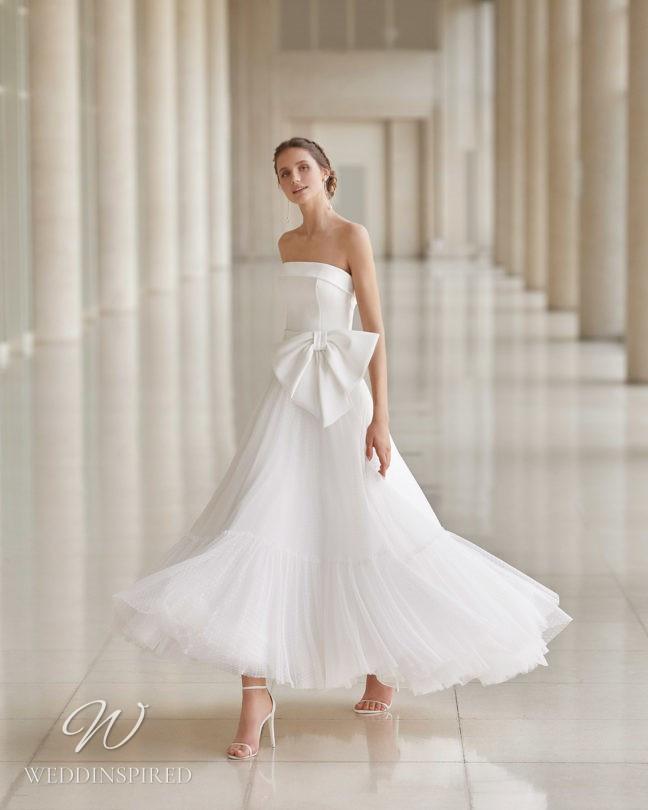 An Aire Barcelona 2021 strapless tulle and satin tea length wedding dress