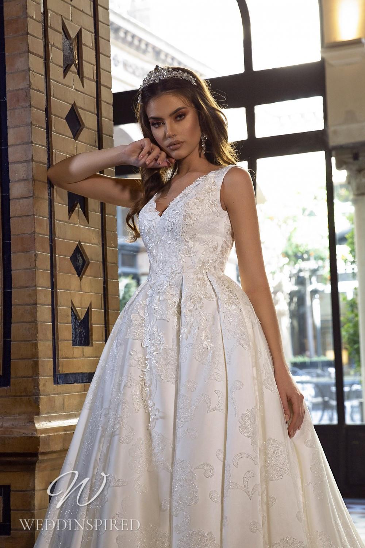 A Maks Mariano lace princess wedding dress