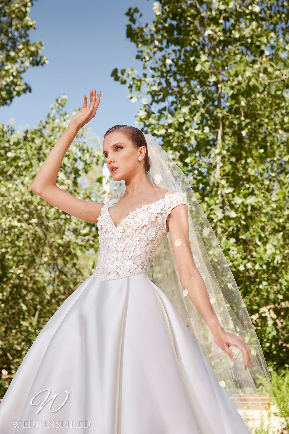 An Elie Saab Spring 2021 satin and lace romantic ball gown wedding dress with a v neck and cap sleeves