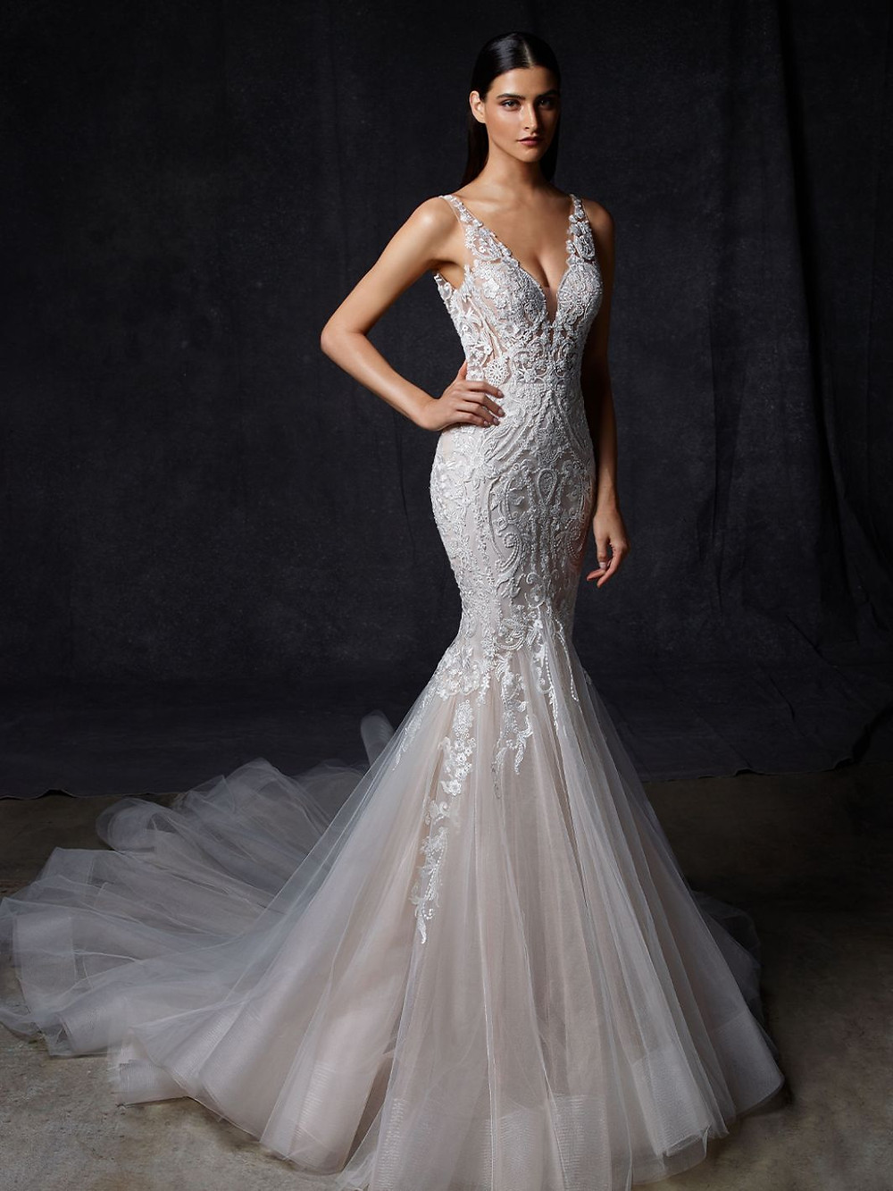 An Enzoani lace mermaid wedding dress with straps and a tulle skirt