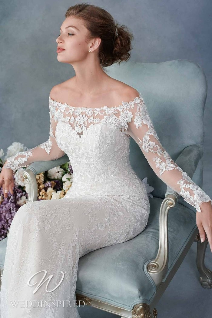 A Kenneth Winston 2021 lace off the shoulder mermaid wedding dress with long sleeves