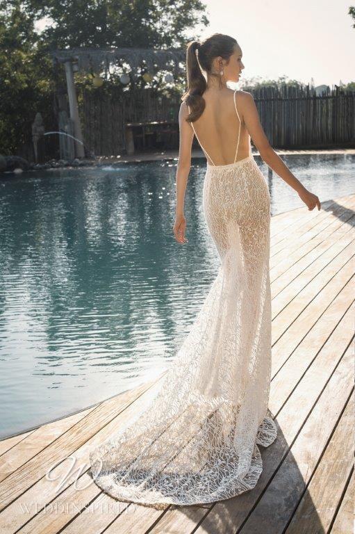 A David Hasbani sexy lace mermaid wedding dress with a v neckline