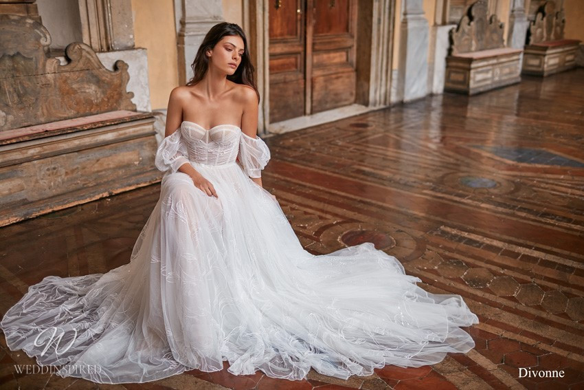 A Gali Karten off the shoulder flowy tulle A-line wedding dress with a sweetheart neckline