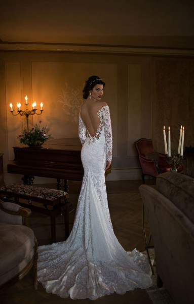 An off the shoulder, lace, ball gown wedding dress with a low back and long sleeves