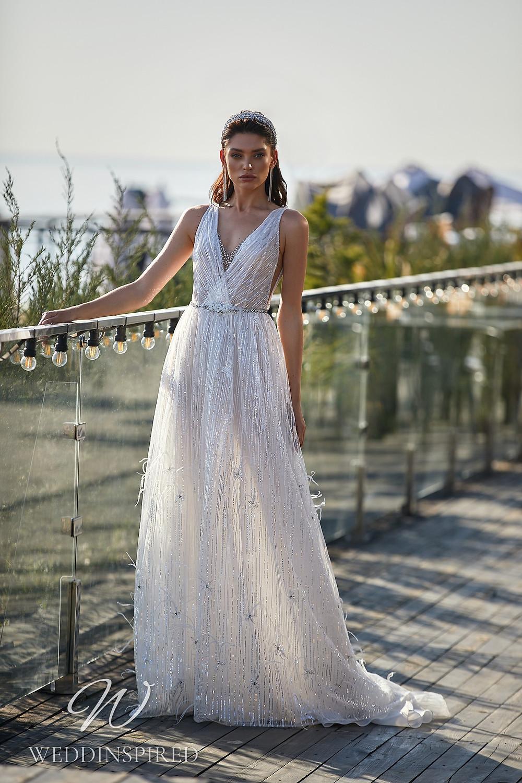 An Ida Torez 2021 silver A-line wedding dress
