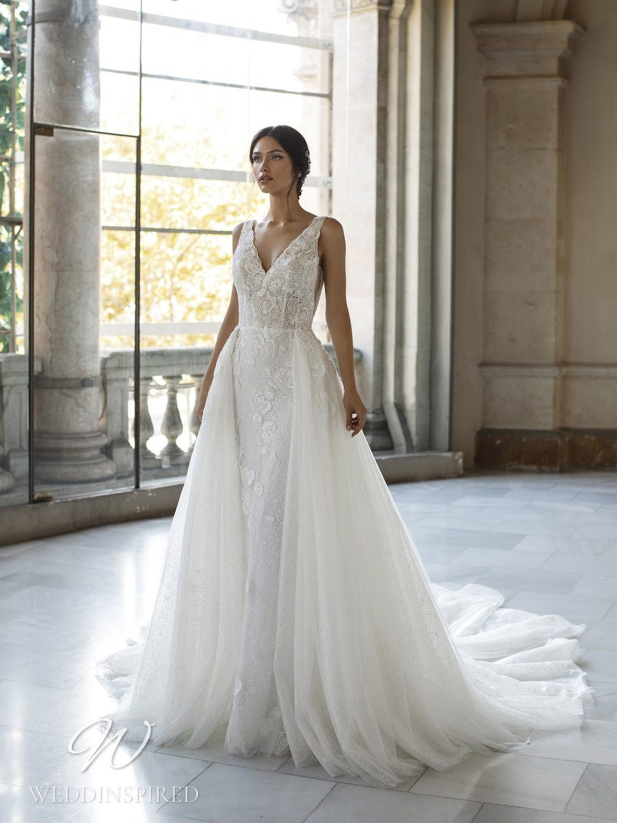 A Pronovias Privée 2021 lace mermaid wedding dress with a detachable skirt, a v neck and straps
