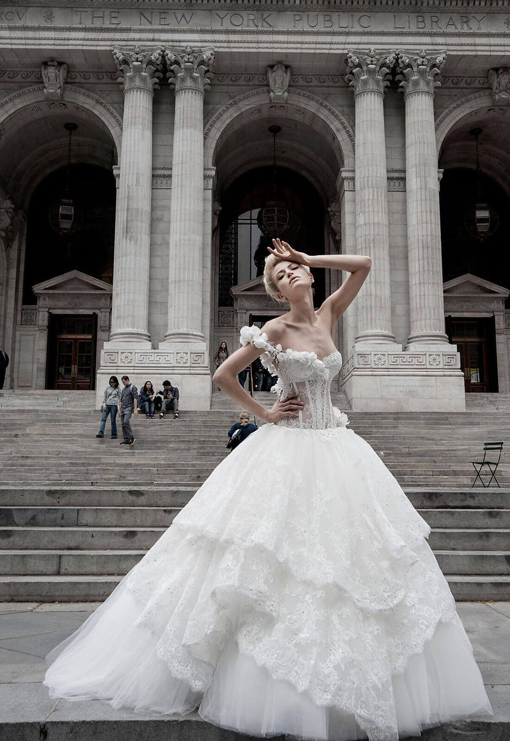 A one shoulder, ball gown wedding dress, with a corset and a large lace skirt