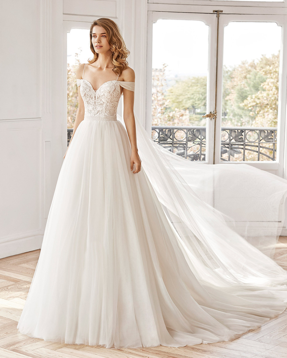 An Aire Barcelona 2020 ivory off the shoulder tulle and lace A-line wedding dress
