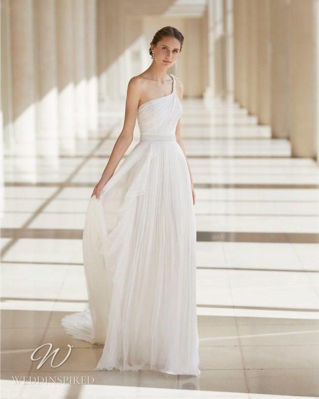 An Aire Barcelona 2021 chiffon Grecian style one shoulder sheath wedding dress