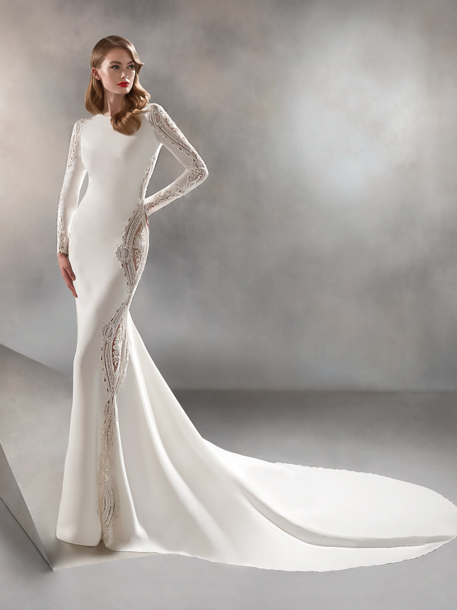 A Pronovias simple modest fitted wedding dress with long lace sleeves