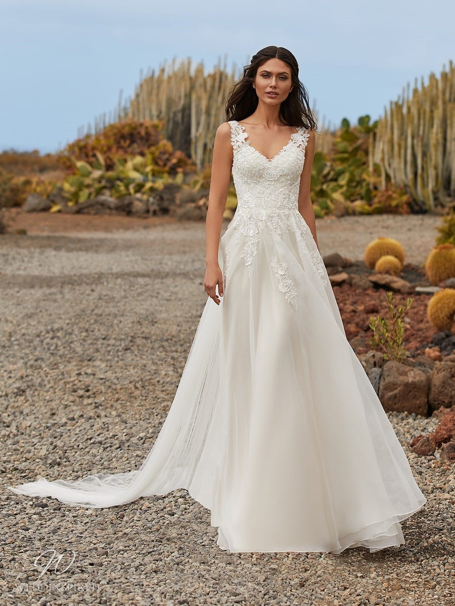 A Pronovias 2021 ivory lace and chiffon wedding dress with straps