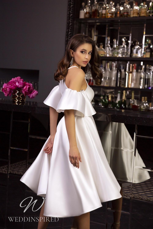 A Tina Valerdi simple satin tea length wedding dress