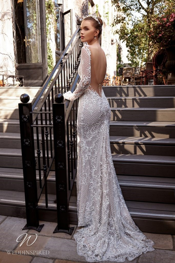 A Julie Vino 2021 lace mermaid wedding dress with long sleeves and a low back