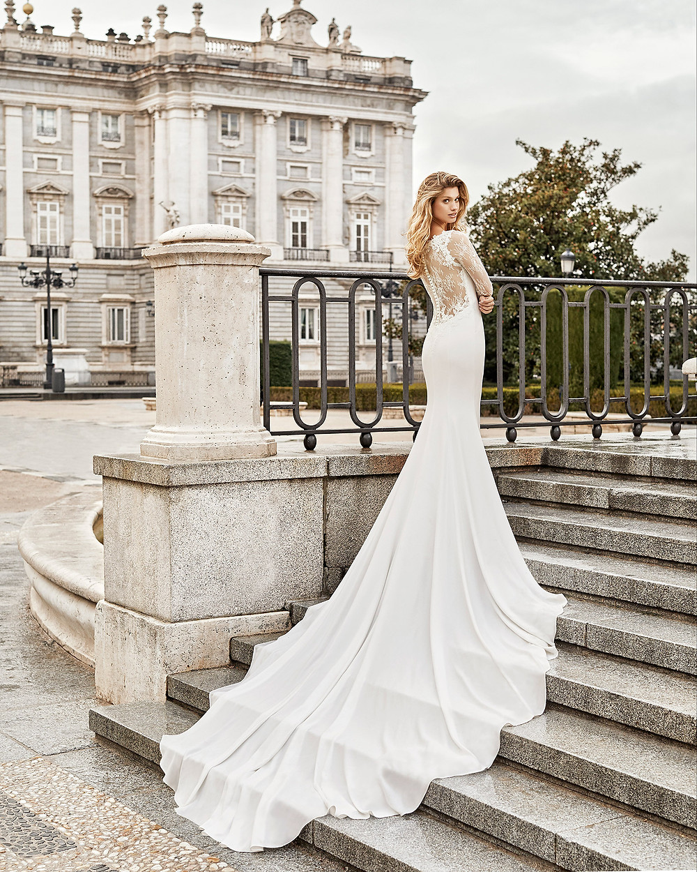 An Aire Barcelona 2020 lace and crepe mermaid wedding dress with a train and an illusion back